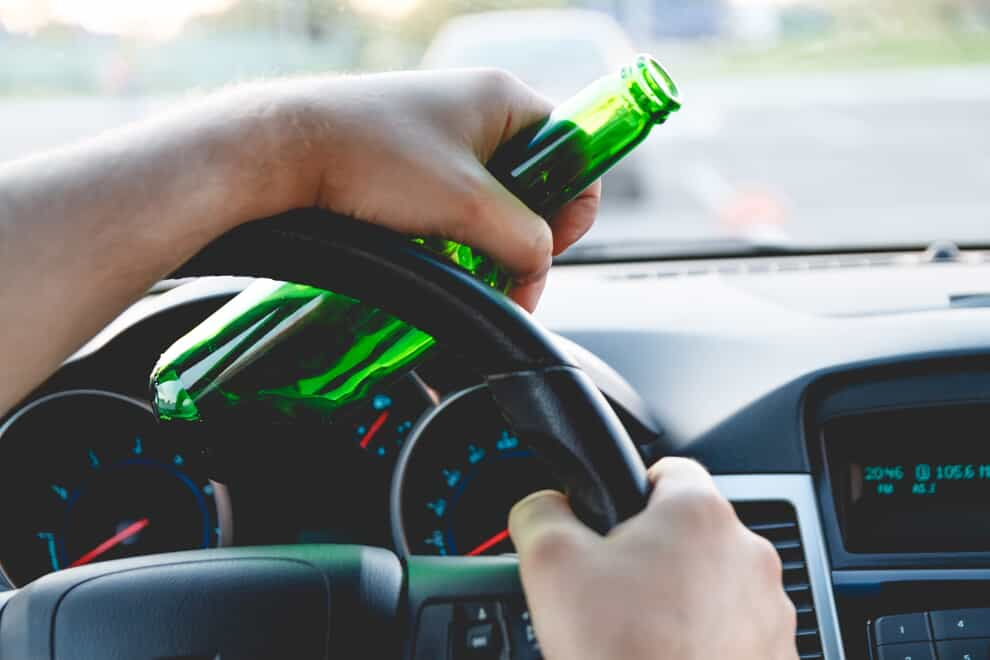 Behind the Wheel with Alcohol in the Left Hand